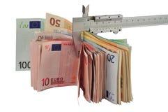 Dinero de medición Foto de archivo libre de regalías