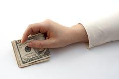 Dinero de ofrecimiento de la mano Imagenes de archivo