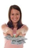 Dinero de ofrecimiento de la mujer foto de archivo