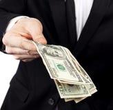 Dinero de ofrecimiento del hombre de negocios Fotos de archivo