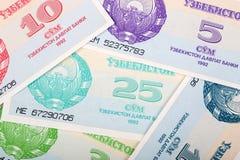 Dinero de Uzbekistán, un fondo foto de archivo