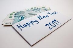 Dinero del Año Nuevo Fotos de archivo