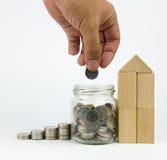 Dinero del ahorro de la mano Imagen de archivo libre de regalías