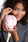 Dinero del ahorro de la mujer Imagen de archivo