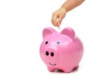 Dinero del ahorro del niño para el futuro Fotos de archivo
