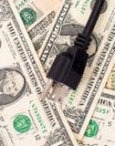 Dinero del ahorro en el Bill eléctrico Fotografía de archivo