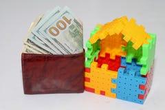 Dinero del ahorro para el hogar Fotografía de archivo libre de regalías