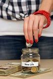 Dinero del ahorro para la nueva vida Imagen de archivo libre de regalías