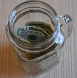 Dinero del ahorro por un día lluvioso Fotos de archivo libres de regalías