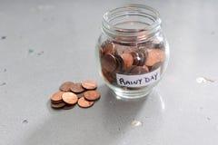 Dinero del ahorro por un día lluvioso Foto de archivo libre de regalías