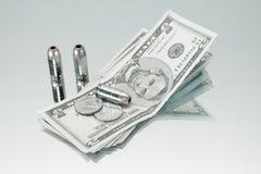 Dinero del arma Fotos de archivo libres de regalías