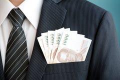 Dinero del baht tailandés (THB) en bolsillo del traje Fotografía de archivo libre de regalías
