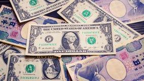 Dinero del billete de banco del dólar de EE. UU. y de los yenes japoneses Imagen de archivo libre de regalías
