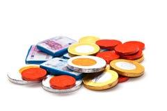 Dinero del chocolate Imagenes de archivo