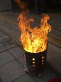 Dinero del fantasma de la quemadura en estufa Fotografía de archivo libre de regalías