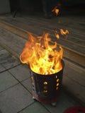 Dinero del fantasma de la quemadura en estufa Fotos de archivo