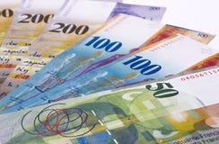 Dinero del franco suizo aislado en el fondo blanco foto de archivo