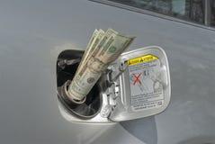 Dinero del gas Fotos de archivo libres de regalías