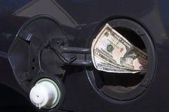 Dinero del gas Fotografía de archivo libre de regalías