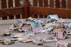 Dinero del kyat donado para un templo Imagen de archivo