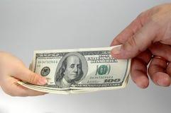 Dinero del niño y del adulto fotos de archivo