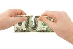 Dinero del rasgón de las manos Imagen de archivo libre de regalías