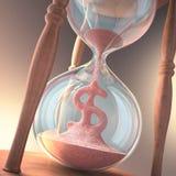 Dinero del reloj de arena Imágenes de archivo libres de regalías