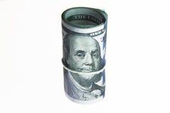Dinero del rollo de los billetes de dólar Imagen de archivo
