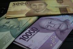 Dinero del rupia de Indonesia imagenes de archivo