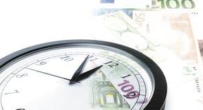 Dinero del tiempo de reloj Foto de archivo libre de regalías
