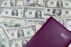 Dinero, el motor de la economía foto de archivo