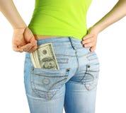 Dinero en bolsillo y mano Foto de archivo libre de regalías