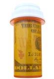 Dinero en botella de píldora Fotos de archivo libres de regalías