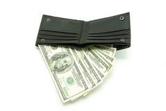 Dinero en carpeta Foto de archivo libre de regalías
