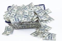 Dinero en carro de la compra foto de archivo
