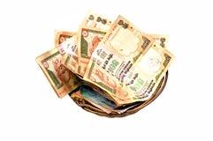 Dinero en cesta Imagen de archivo