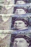 Dinero en circulación británico Cierre para arriba de británicos los billetes de banco de 20 libras Foto de archivo