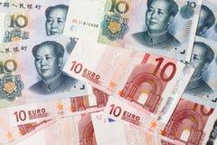 Dinero en circulación chino y euro Imagen de archivo libre de regalías
