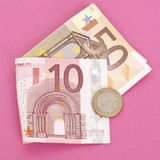 Dinero en circulación euro con una torcedura moderna Foto de archivo libre de regalías