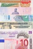 Dinero en circulación global Fotos de archivo libres de regalías