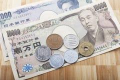 Dinero en circulación japonés Imagen de archivo libre de regalías