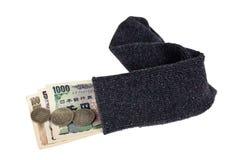 Dinero en circulación japonés en un calcetín Fotografía de archivo libre de regalías