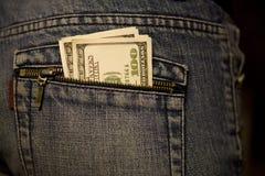 Dinero en el bolsillo Fotografía de archivo libre de regalías