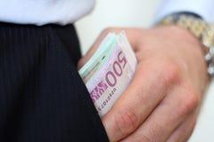 Dinero en el bolsillo Fotos de archivo