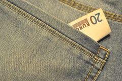 Dinero en el bolsillo fotos de archivo libres de regalías