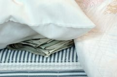 Dinero en el colchón Fotografía de archivo libre de regalías