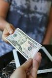 Dinero en el fondo de la tableta Imagen de archivo libre de regalías
