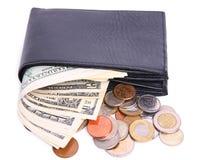Dinero en el monedero aislado foto de archivo