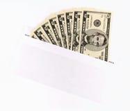 Dinero en el sobre Foto de archivo