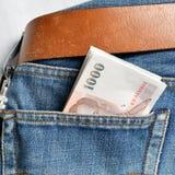 Dinero en Jean Imagenes de archivo